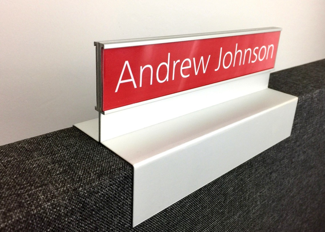 C Channel sign - double sided sign mounted to top of workstation screen