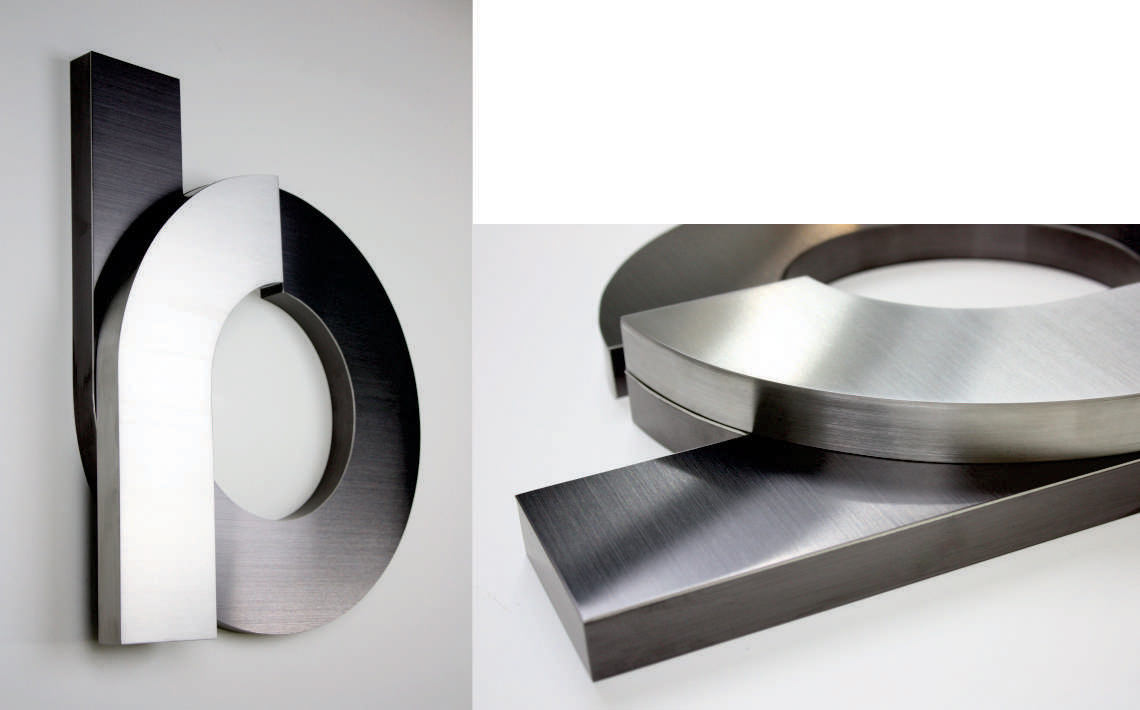 Fabricate3D Logo in Stainless Steel and Black Titanium