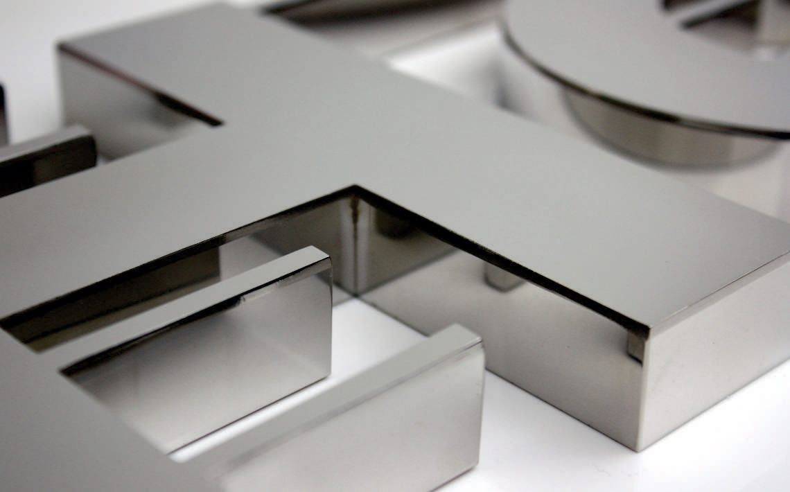 Fabricate3D John Holland Logo in Polished Stainles Steel Detail
