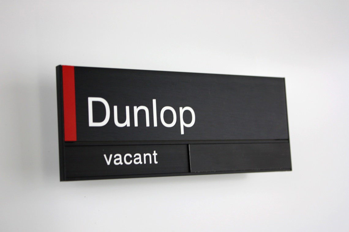 AM Series Room Sign with occupancy slider Black Anodised with vinyl detail and Vacant / In Use Slider